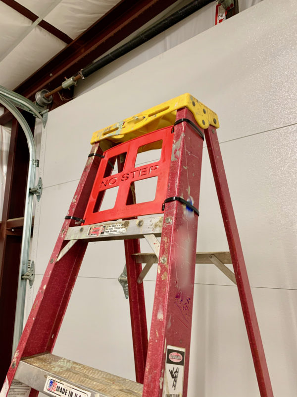 Red ladder safety guard installed