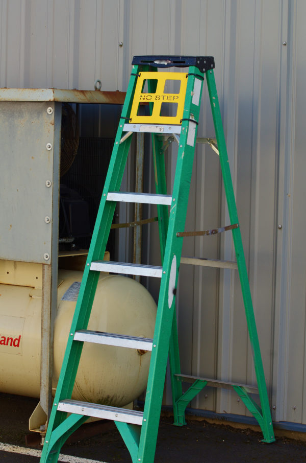 Yellow ladder safety guard installed